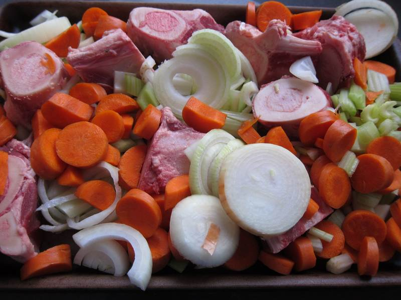Beef Stock: bones, carrots and onions ready for roasting
